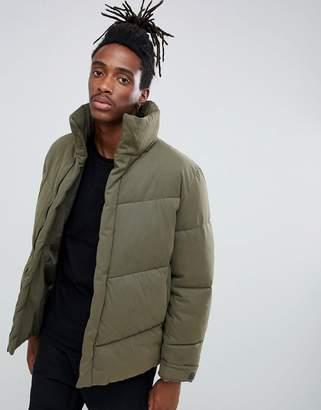 Asos DESIGN oversized puffer jacket in khaki