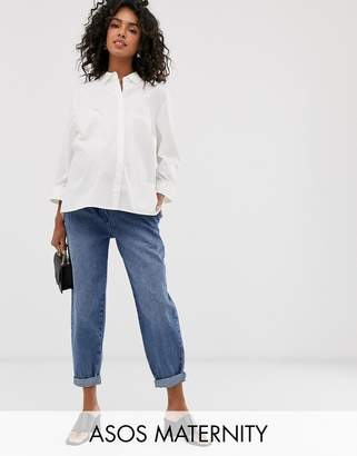 Asos DESIGN Maternity tapered leg boyfriend jeans with curve seam in mid vintage wash with over the bump band