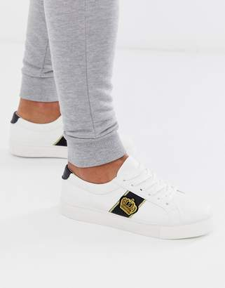 Design DESIGN trainers in white with crown badge embroidery