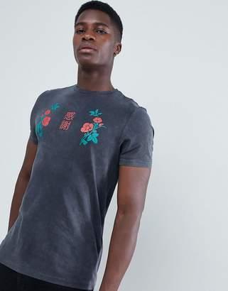 Asos DESIGN t-shirt with rose yoke print and acid wash
