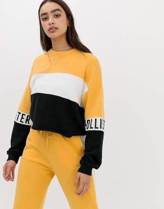 Hollister raw hem sweatshirt with arm logo in color block