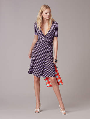 Short Sleeve Flared Wrap Dress $468 thestylecure.com