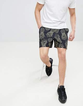 Asos DESIGN slim shorter shorts in black with pineapple print