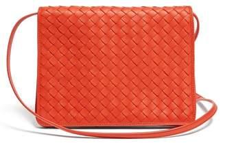 37b17cd50fc1 Bottega Veneta Intrecciato Woven Leather Cross Body Bag - Womens - Red