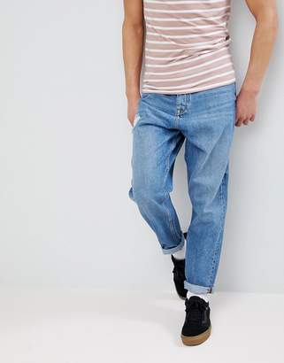 Asos Oversized Tapered Jeans In Mid Wash With Rip
