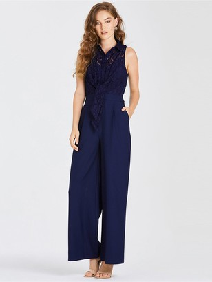 dbf7557b95 Little Mistress Lace Top Belted Jumpsuit - Navy