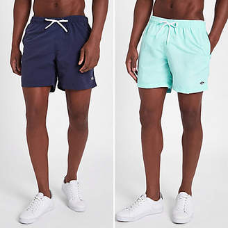 River Island Navy and mint blue short swim trunks pack