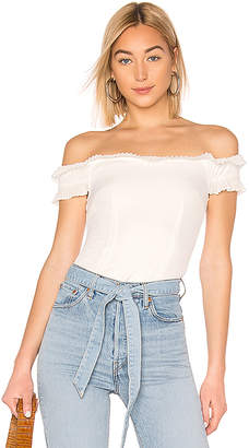 About Us Caitlyn Strapless Frill Top
