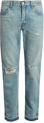 GUCCI Slim-fit cropped distressed jeans $820 thestylecure.com
