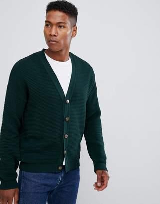 Asos Design DESIGN Ribbed Cardigan With Dropped Shoulder In Bottle Green