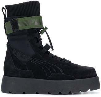 98d0892ca964 Shop New In at Farfetch · FENTY PUMA by Rihanna high ankle lace up Scuba  boots