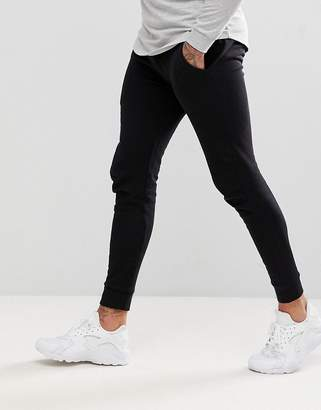 Asos DESIGN super skinny joggers in black