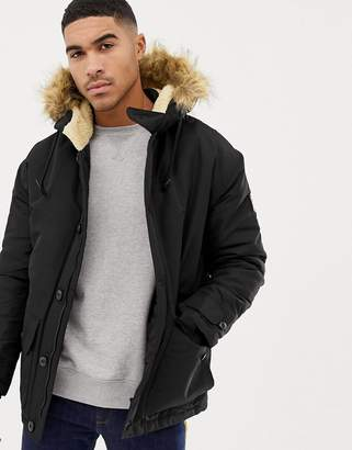 Nicce London parka jacket in black with fur hood