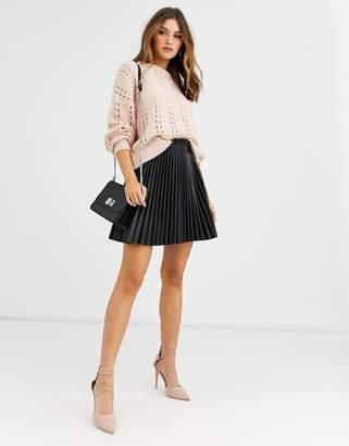 Vero Moda pleated mini leather look skirt in black