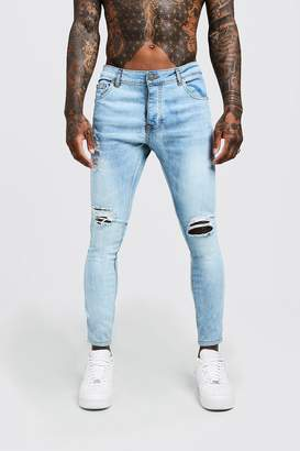 76b4612cccdbab boohoo Skinny Fit Jeans With Ripped Knee And Side Tape