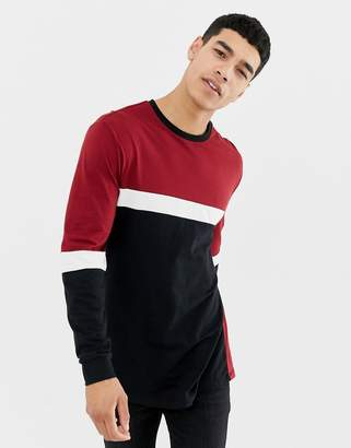 Asos DESIGN relaxed longline long sleeve t-shirt with contrast body panel in burgundy