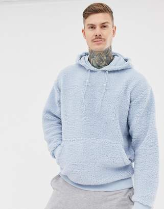 Asos DESIGN oversized hoodie in borg with toggles in light blue