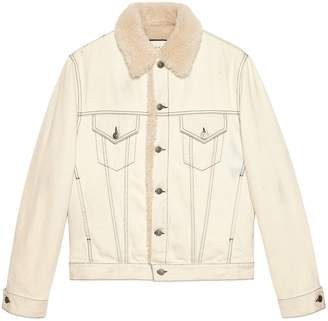 Gucci Shearling lined denim jacket with sketch snake print