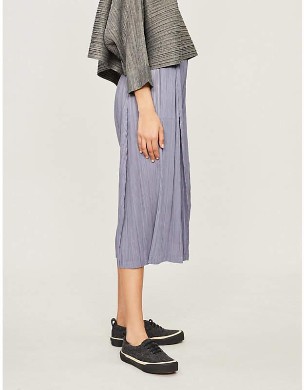 Skew cropped wide-leg pleated trousers