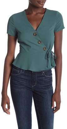 HIATUS Short Sleeve Asymmetrical Button Wrap Blouse