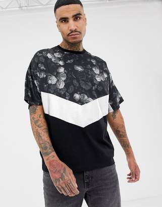 Asos Design DESIGN oversized t-shirt with floral chevron yoke and silver foil colour blocking panel