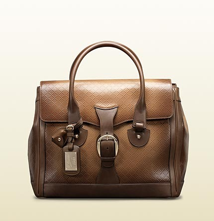 Gucci carry-on duffel with key holder and identification tag with 'G.Gucci Firenze 1921' script metal plate.