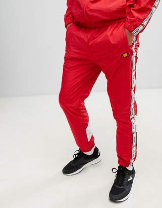 Ellesse Avico shell suit track joggers with taping in red