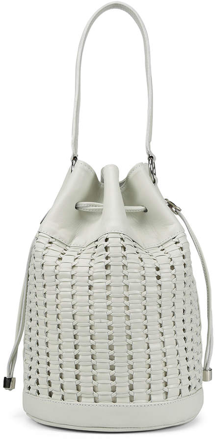 DORINDA DORINDAS - A spring season must-have, the DORINDA in woven nappa leather tops our bucket list. Detailed with a slouchy design, drawstring closure and polished metal hardware, this small carryall handbag completes your warm weather wardrobe. Made on the Beaches of Spain.
