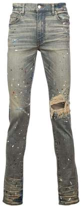 Amiri paint splatter distressed skinny jeans