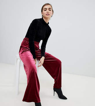 Monki velvet pants in red