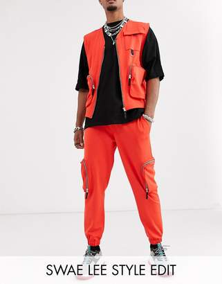 Asos Design DESIGN co-ord skinny utility cargo joggers in orange poly tricot