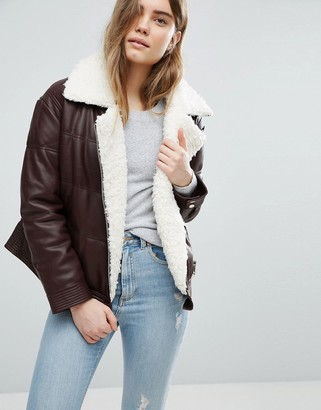 ASOS Leather Look Padded Jacket with Aviator Styling and Borg Liner $113 thestylecure.com