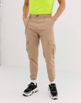Bershka cargo pants with chain in tan