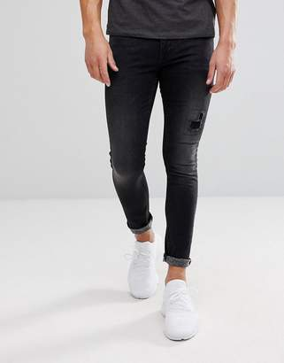 Asos Super Skinny Jeans In Vintage Washed Black With Rip And Repair