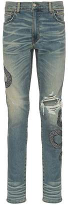 Amiri snake embroidered distressed jeans