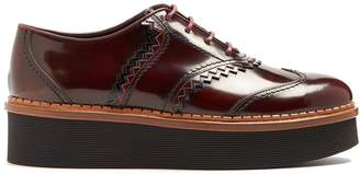 Tod's Pinked-edge raised-sole leather shoes