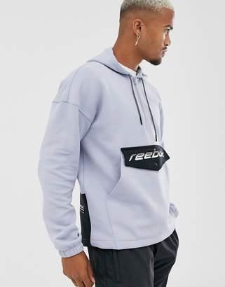 Reebok overhead half zip jacket in blue with logo pocket