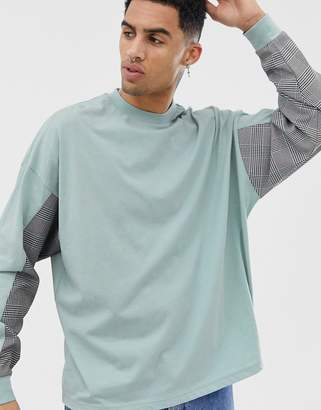 Asos Design DESIGN oversized long sleeve t-shirt with woven check cut and sew panels on sleeves