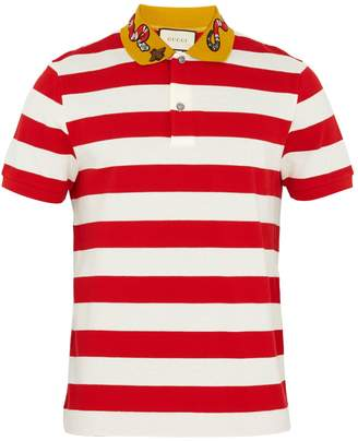 GUCCI Embroidered striped polo shirt $675 thestylecure.com