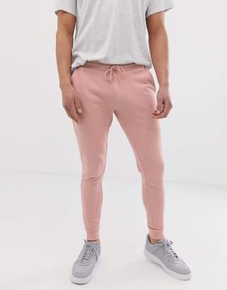 Asos Design DESIGN super skinny joggers in pink