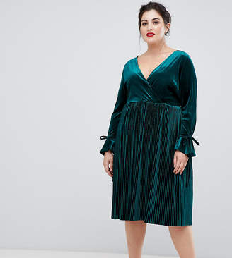 Lovedrobe wrap front velvet dress with pleated skirt in emerald green