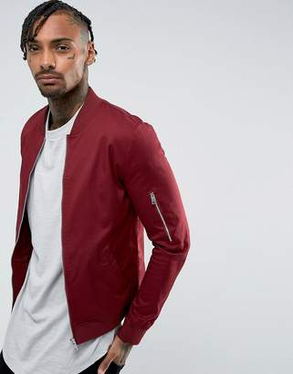 Asos DESIGN muscle fit bomber jacket with sleeve zip in oxblood