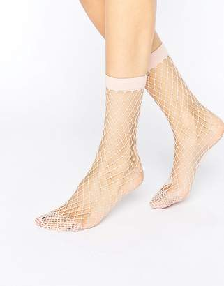 Asos Oversized Fishnet Ankle Socks In Pink