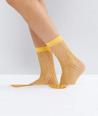 Asos Design Oversized Fishnet Ankle Socks in Orange