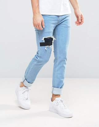Religion Jeans in Slim Stretch Fit with Rips and Elastic Patch