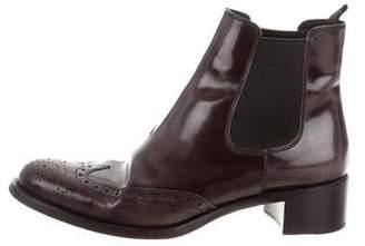 Miu Miu Wing-Tip Patent Leather Boots
