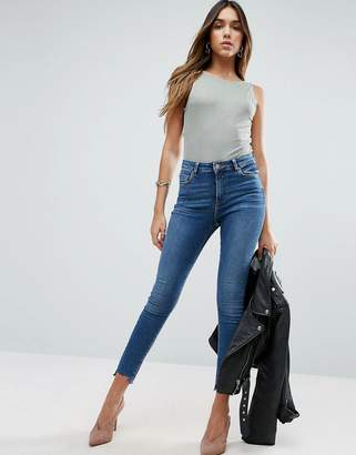 Asos DESIGN Ridley skinny jeans in roy dark stonewash with Stepped hem