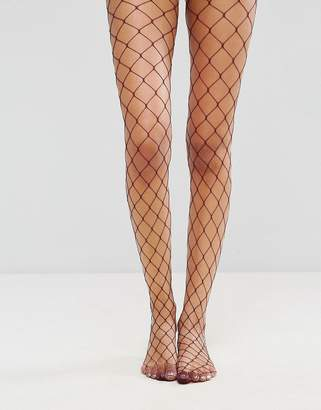 Asos Oversized Fishnet Tights In Berry