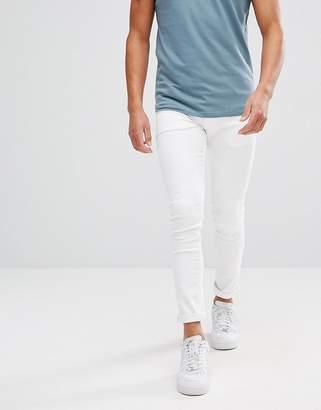 Asos DESIGN Super Skinny Jeans In White