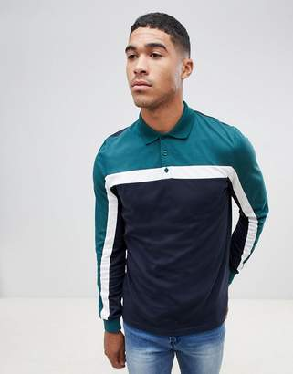 Asos DESIGN long sleeve polo shirt with color block in navy